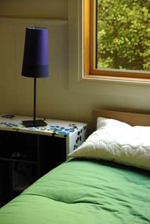 Bed and lamp on side table in bedroom 2.