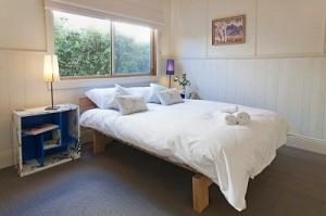 Queen size bed in bedroom 2.